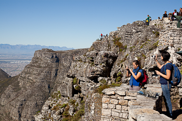 People take in the view from Table Mountain in Cape Town
