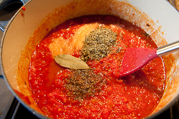 Adding remaining ingredients into pizza sauce