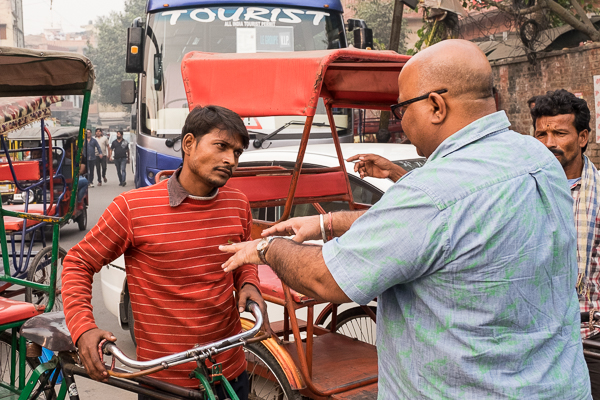Negotiating our cycle rickshaw ride through Old Delhi