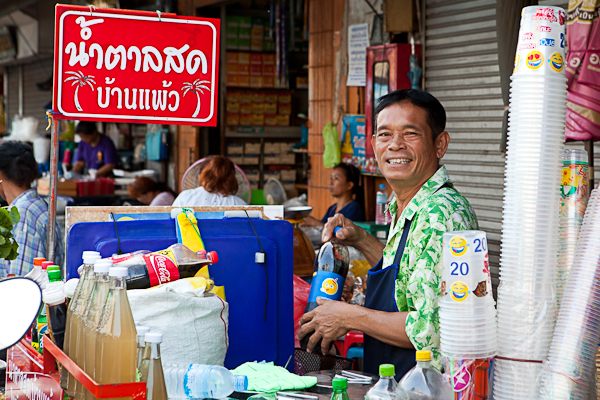 Smiling man at Mahachai market